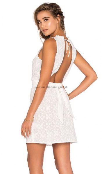 white mini crochet dress with matching sandals