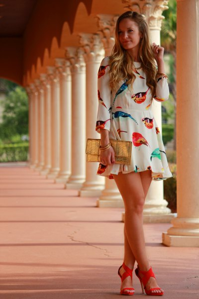 white mini ruffle dress with strappy heels with open toes