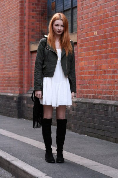 white mini dress with black jacket and boots