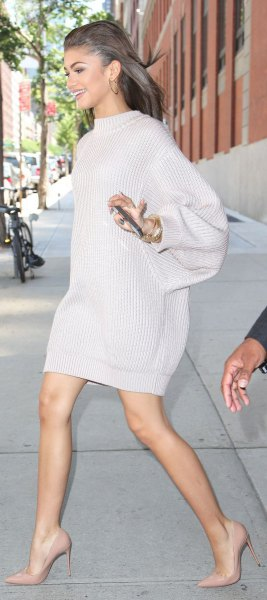 white, chunky sweater dress with stand-up collar and pink high heels