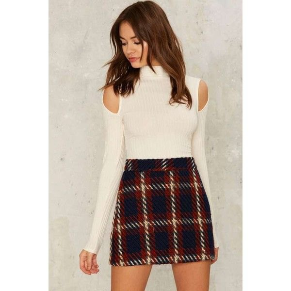 white ribbed sweater with cold shoulder and false neck and black checked wool mini skirt