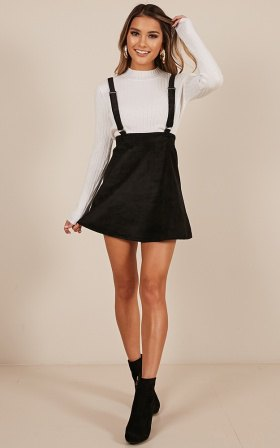 white sweater with mock neck and black suspender cord skater skirt