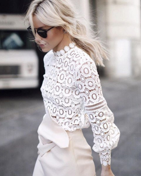 white wrap skirt made of lace blouse with leather neck