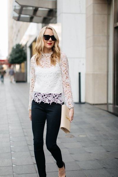 white long-sleeved lace top with stand-up collar over the vest top