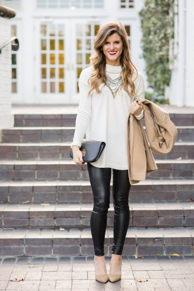 white sweater with a long neckline, leggings and pink heels
