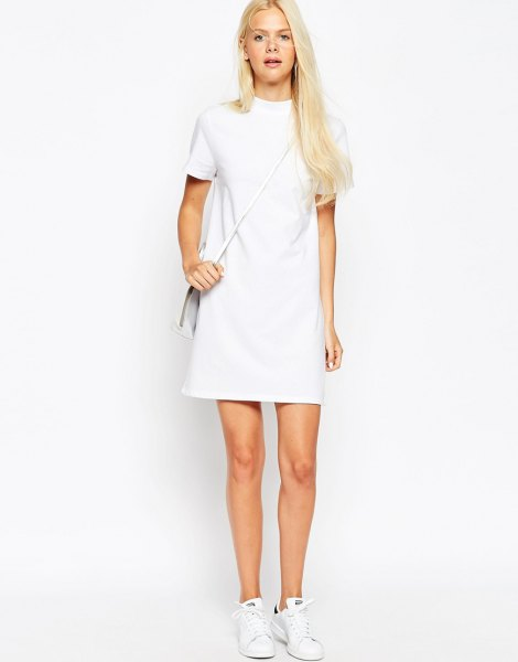 white short-sleeved mini dress with mock neck and sneakers