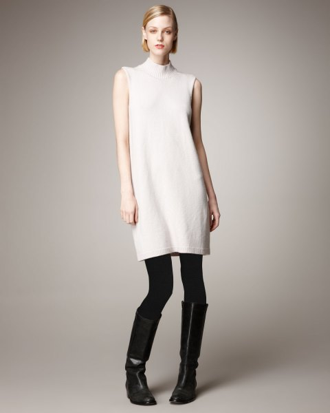 white sleeveless cashmere long-linen sweater with stand-up collar, leggings and boots