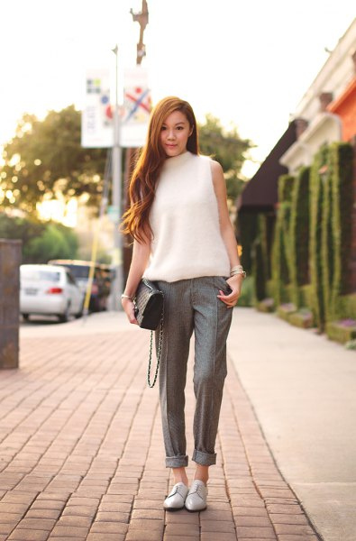 white sleeveless knitted sweater tweed pants with mock neck