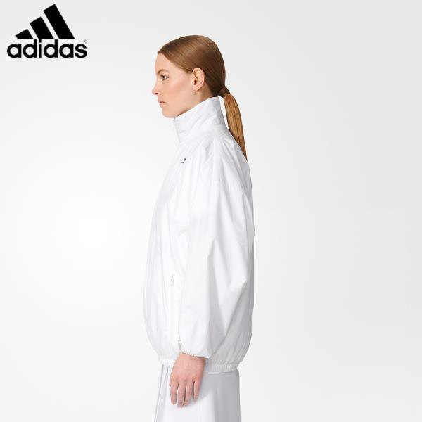 white windbreaker with mock neck and running shorts