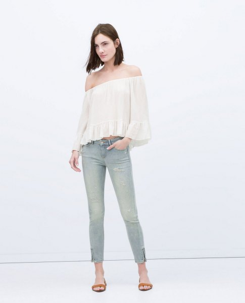 white off-the-shoulder blouse light gray jeans with ankle zip
