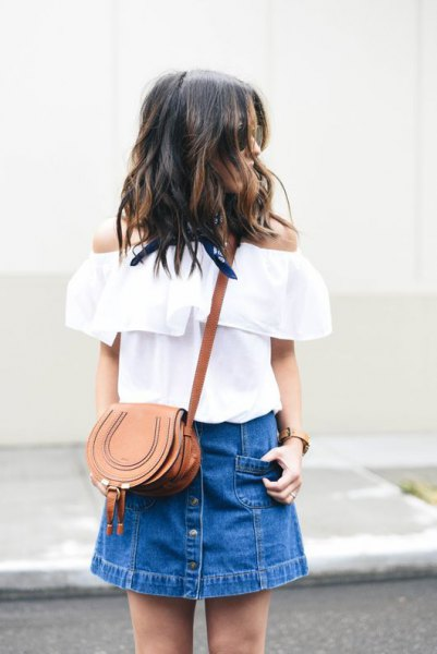 white strapless blouse with blue mini skirt