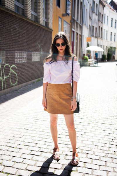 white off-the-shoulder blouse with brown skirt and sandals