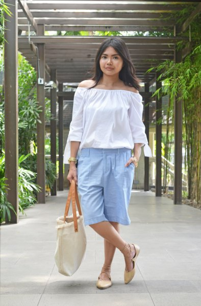 Off-shoulder white blouse with light blue, knee-length, long cotton shorts