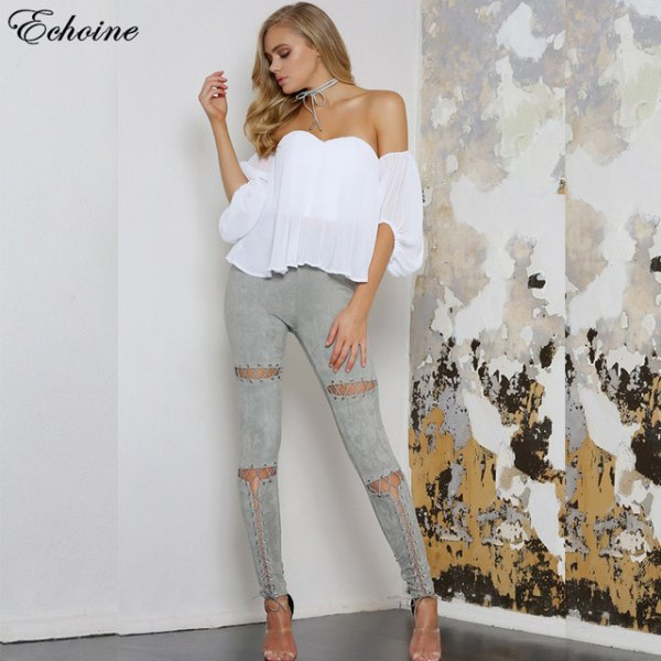 white strapless chiffon blouse with gray skinny jeans