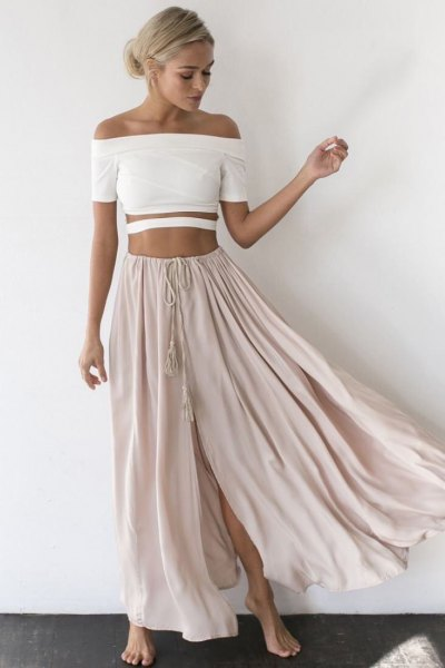 white strapless crop top with light gray, long, flowing skirt