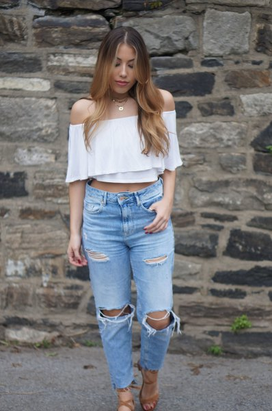 white strapless cropped blouse with ripped knee mom jeans