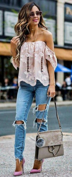 white strapless top with floral embroidery and boyfriend jeans