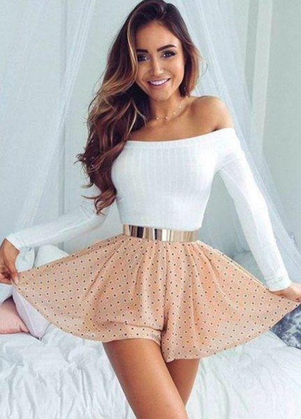 white strapless, figure-hugging sweater with blushing pink polka dot high-rise skater skirt