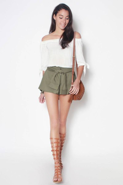 white, off-the-shoulder, short-sleeved blouse with green tie shorts