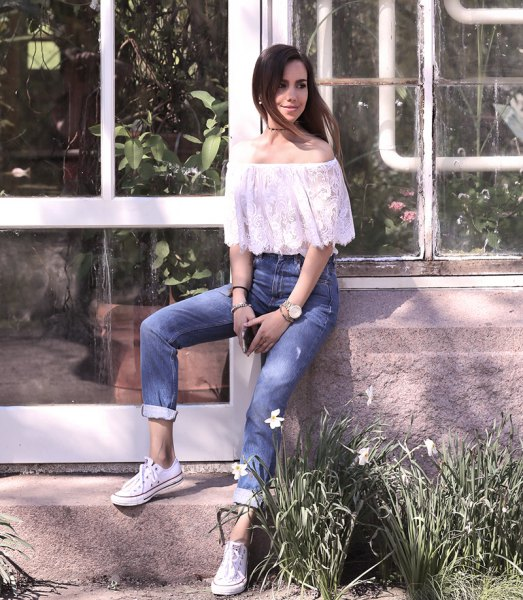 white lace off the shoulder top with cuffed jeans and sneakers