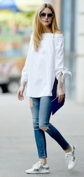white off the shoulder long blouse with ripped ankle jeans