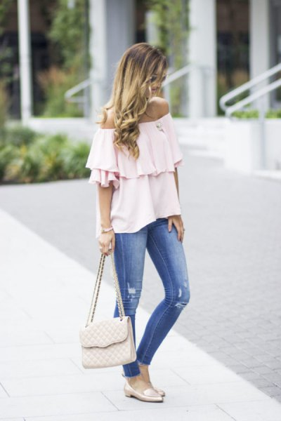 white off-the-shoulder ruffle blouse with blue jeans and pink slippers