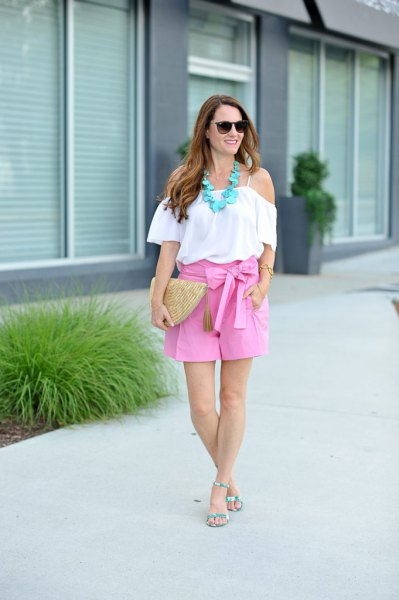 white, off-the-shoulder ruffle blouse with flowing shorts with pink bow
