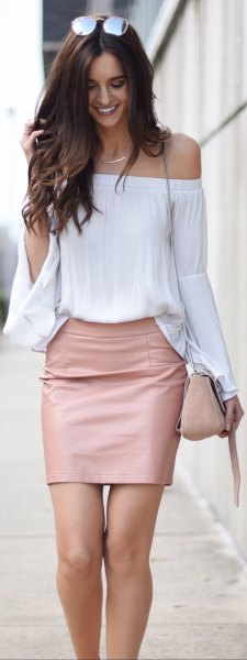 Off the shoulder wide sleeve blouse with a red mini skirt