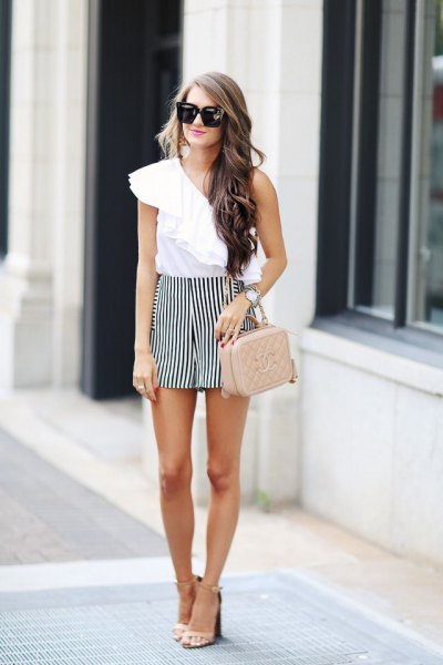 white ruffle top with one shoulder and black striped, flowing shorts