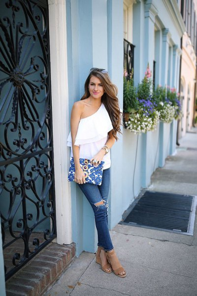 white ruffle top with one shoulder and blue jeans