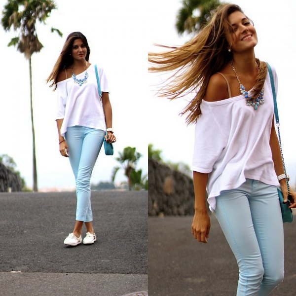 white one-shoulder short-sleeved sweater with light blue cuff pants