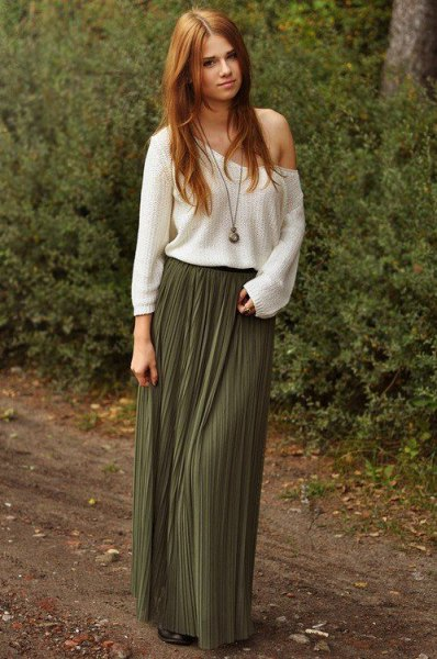 white strapless sweater with pleated floor-length skirt