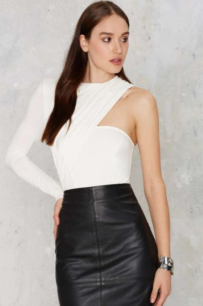 white bodysuit blouse with one sleeve and black leather skirt