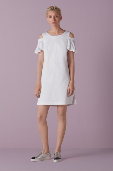 white mini shift dress with ruffled sleeves and open shoulders