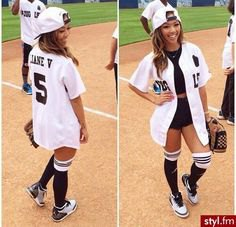 white oversized baseball jersey shirt with black crop top and mini jean shorts