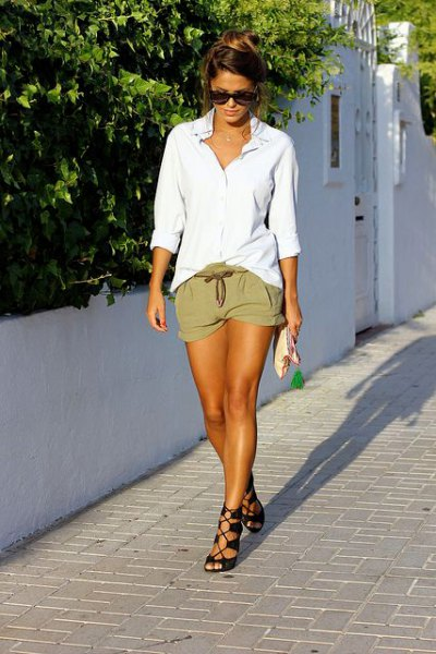 white oversized shirt with buttons and tie-waist khaki mini-shorts