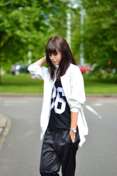 white oversized jacket with black printed t-shirt and wide pants