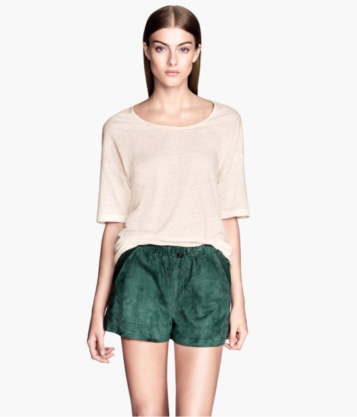 white oversized t-shirt dark gray suede shorts