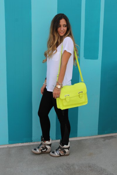 white oversized t-shirt with camo sneakers with hidden wedge and lemon yellow wallet