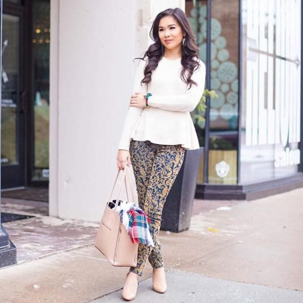 white peplum knit sweater with pink and blue drainpipe trousers with tribal print