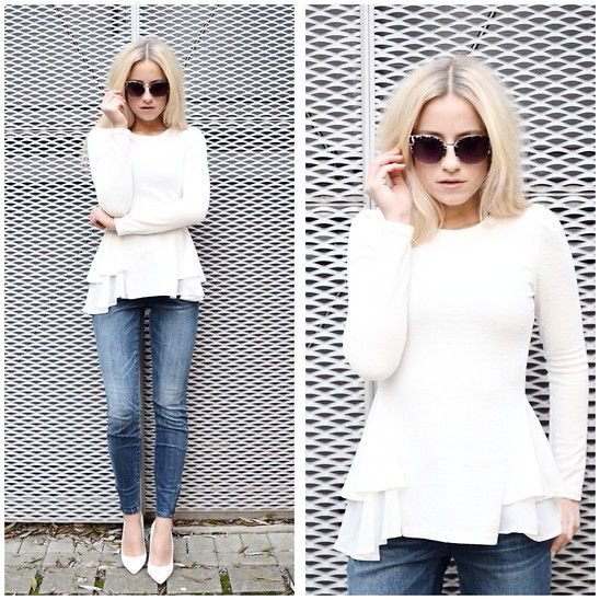 white peplum sweater with frilled blouse and jeans