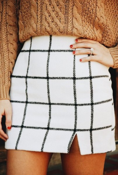 white checked mini skirt with a green, chunky sweater with a cable cutout