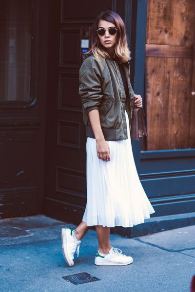 white pleated maxi dress made of chiffon with gray leather aviator jacket