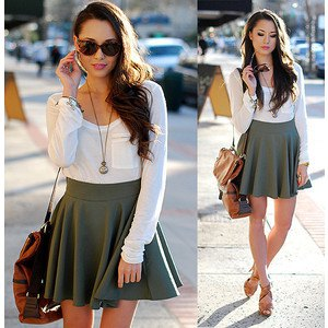 white long-sleeved t-shirt with pocket front and gray mini skirt with high waist