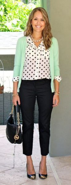 white polka dot shirt cream-colored cardigan black drainpipe pants