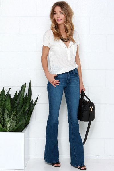 white polo shirt with blue flared jeans and open toe heels