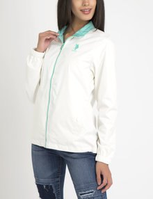 white polo windbreaker with blue ribbed skinny jeans