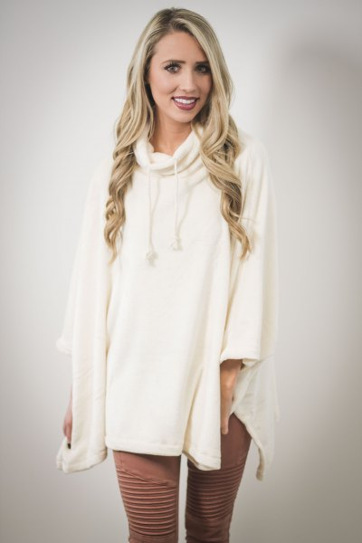 white poncho green patterned leggings