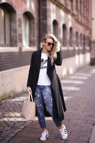 white printed t-shirt and ripped jeans