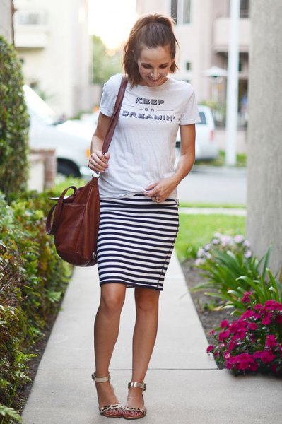 white printed T-shirt with silver heels